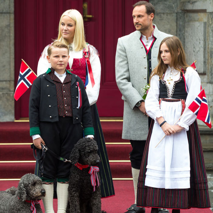 Crown Prince Haakon, Crown Princess Mette-Marit, their children Prince Sverre Magnus and Princess Ingrid Alexandra along with their royal pups greeted kids during the National Day parade at their home, Skaugum in Asker, Norway on May 17.