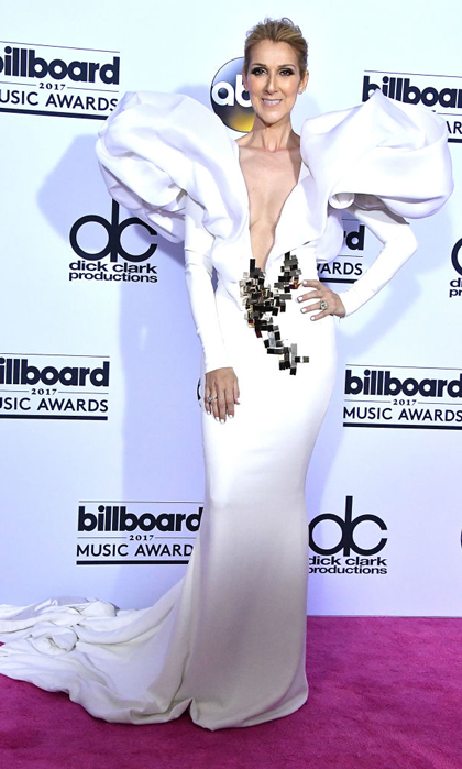 Celine Dion took shoulder pads to a new extreme in a white plunging gown by Stéphane Rolland at the 2017 Billboard Music Awards.