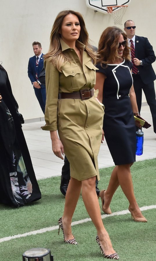 A khaki military shirt dress and zebra print stilettos were the choice for the First Lady's tour of the American International School in the Saudi capital Riyadh on May 21, 2017.