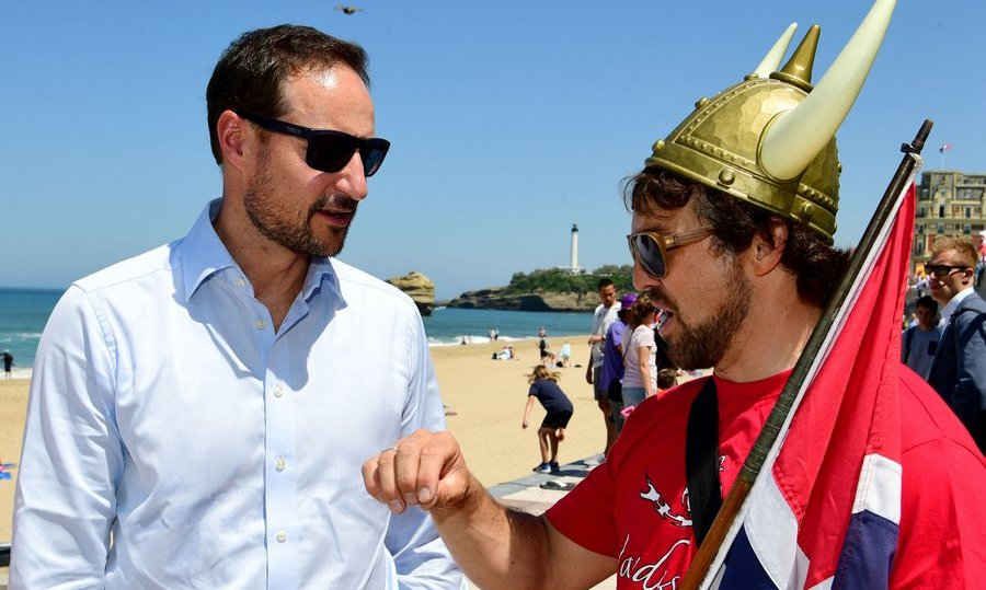 The future king of Norway, Crown Prince Haakon, left, greeted Franco-Norwegian handi-surf champion Ismael Guilliorit on the beach in Biarritz, France, during the 2017 ISA World Surfing Games on May 24.