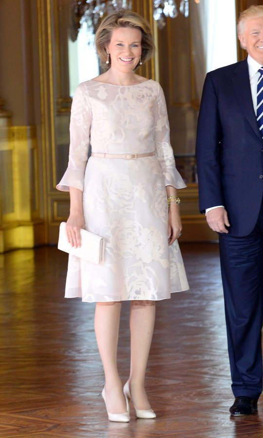 Queen Mathilde of Belgium was pretty in pastels as she greeted President Donald Trump and First Lady Melania Trump at the Royal Palace in Brussels.