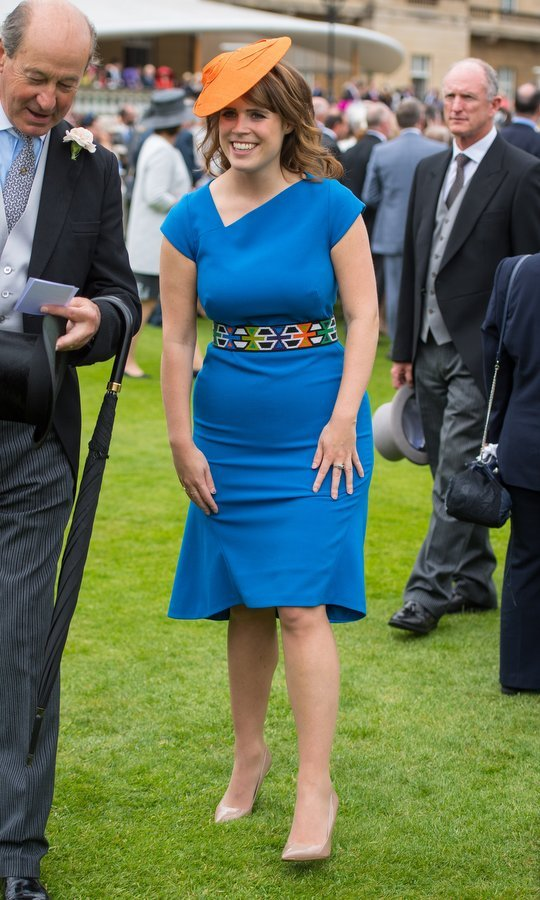 We're loving Princess Eugenie's colorful outfit and funky belt, worn to a garden party at Buckingham Palace.