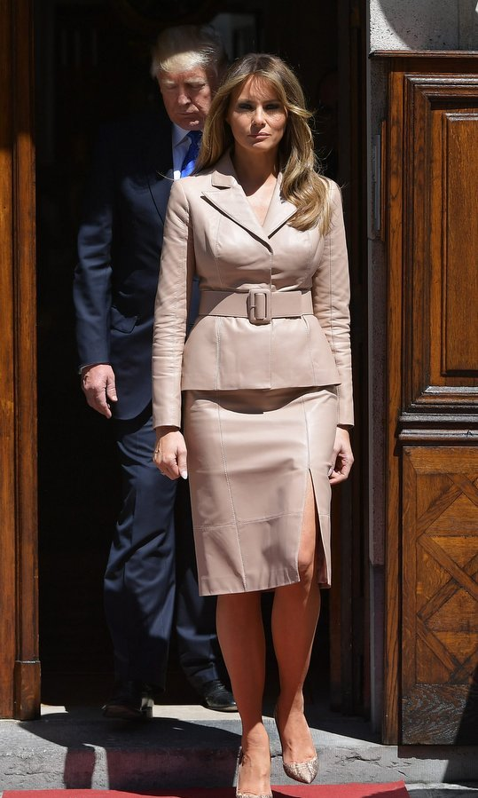 A beige leather power suit was Melania's choice at the US ambassador's residence previous to the NATO (North Atlantic Treaty Organization) summit, in Brussels on May 25.