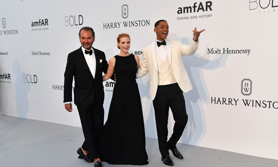 CEO of Moncler Remo Ruffin, Jessica Chastain and Will Smith proved three is not a crowd as they walked the amfAR carpet at the Hotel du Cap - Eden Roc.