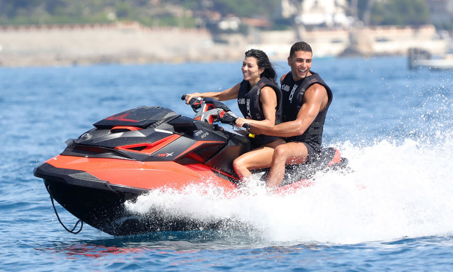Kourtney Kardashian and Younes Bendjima had fun on a wave runner as they took a break from the parties in Cannes.