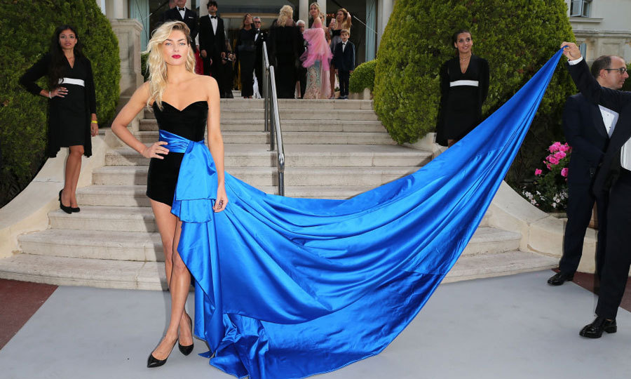 Jessica Hart needed an extra hand to handle her blue train during the amfAR Gala.