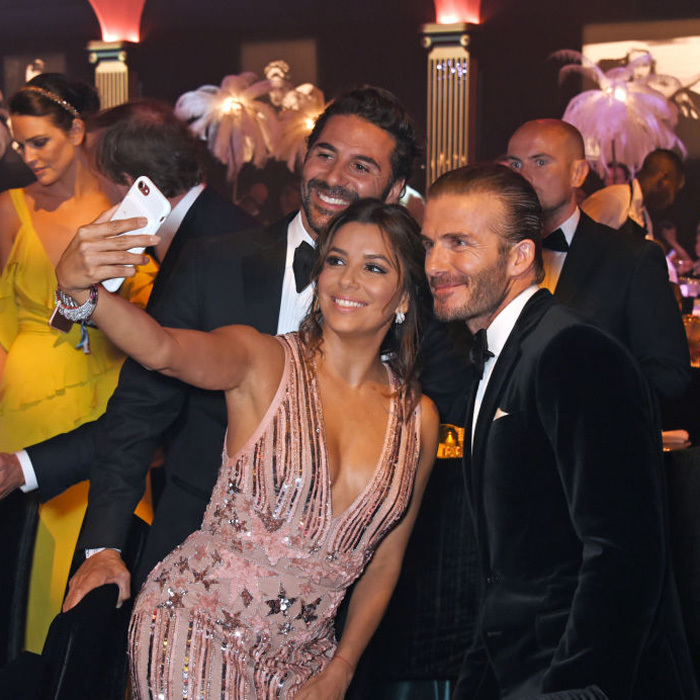 With this guy, it is always a selfie moment! Eva Longoria captured a photo with her husband and David Beckham inside the amfAR Gala in Cannes.