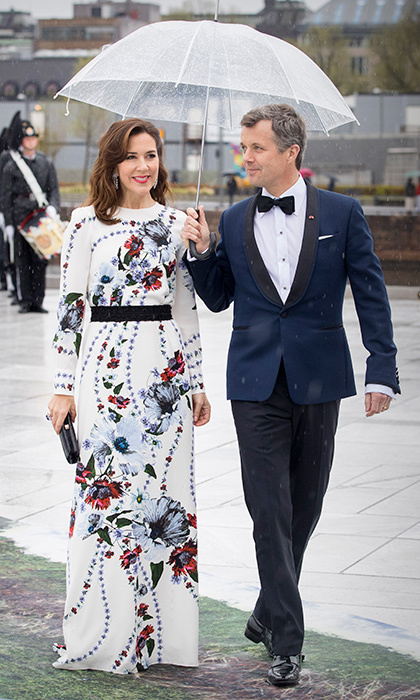 How chivalrous! Prince Frederik looked like a real Prince Charming as he sheltered his wife from the rain during King Harald and Queen Sonja of Norway's 80th birthdays in May 2017 in Oslo. 
