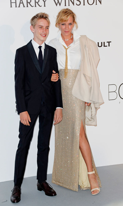 Uma Thurman brought her and Ethan Hawke's 15-year-old son Levon Roan as her date to the amfAR Gala in Cannes.