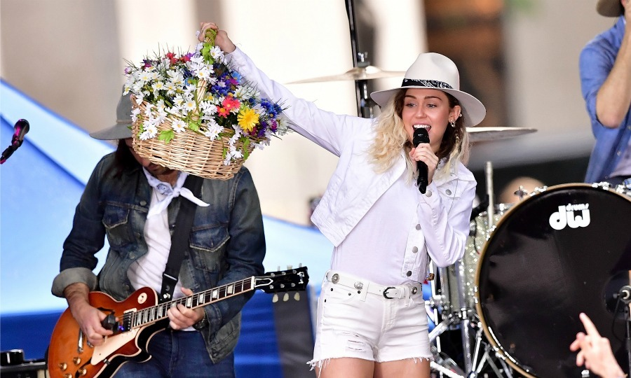 May 26: Miley Cyrus brought the flowers and the fun to her performance at the <i>Today Show</i> in NYC.