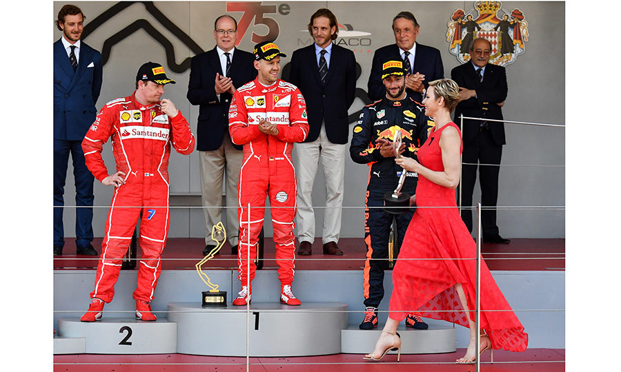 Wearing a red maxidress, Princess Charlene was a fashion winner center stage as she awarded the champions of the Formula One race in Monte-Carlo.