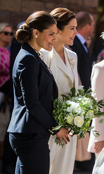 Crown Princess Victoria of Sweden, left, and Crown Princess Mary of Denmark visited the store Ole Lynggaard Copenhagen together on May 29 in Stockholm.