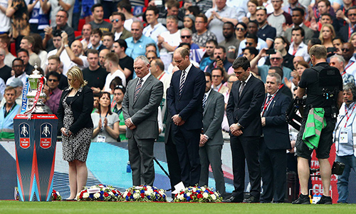 Prior to the FA Cup Final soccer match at London's Wembley Stadium, Prince William, in navy blue suit, center, took part in a minutes' silence in honor of victims of the Manchester terror attack.