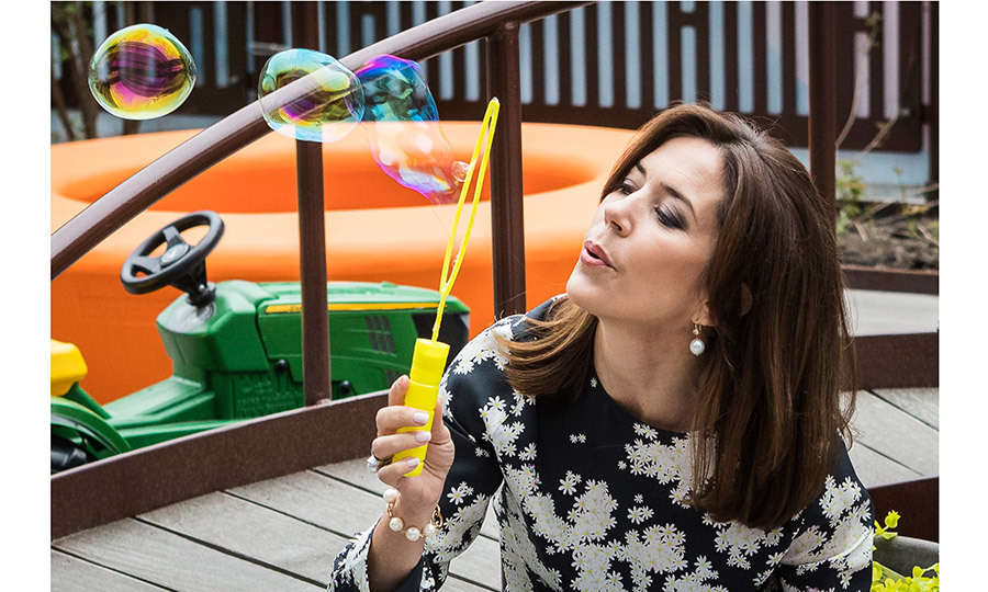 Crown Princess Mary of Denmark had fun playing with some bubbles during her visit to New Karolinska Solna University Hospital in Stockholm, Sweden, during her three-day royal visit with husband Crown Prince Frederik. 