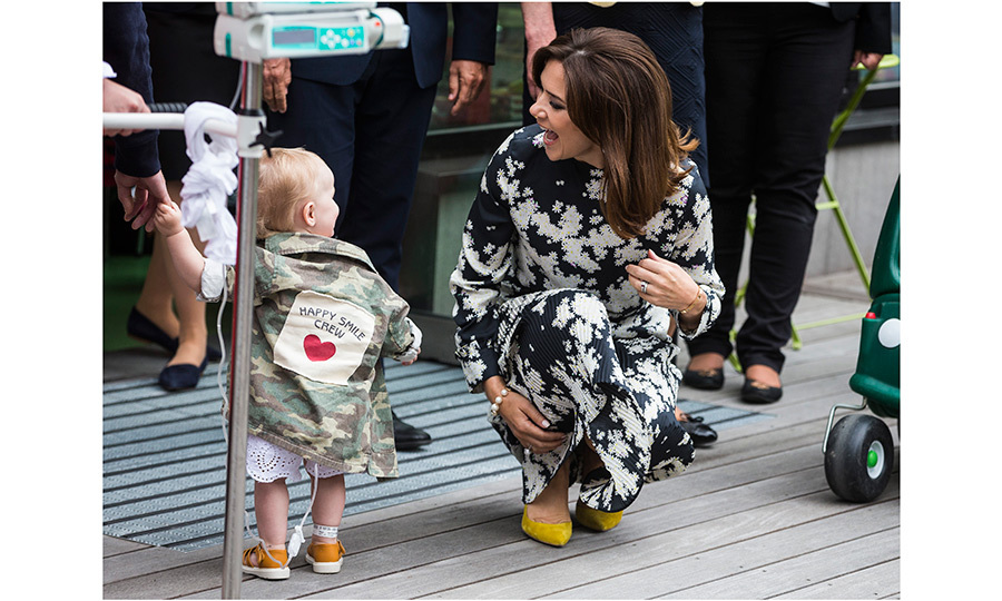 Mom-of-four Crown Princess Mary also met an adorable new friend at Stockholm's New Karolinska Solna University Hospital on May 30. 