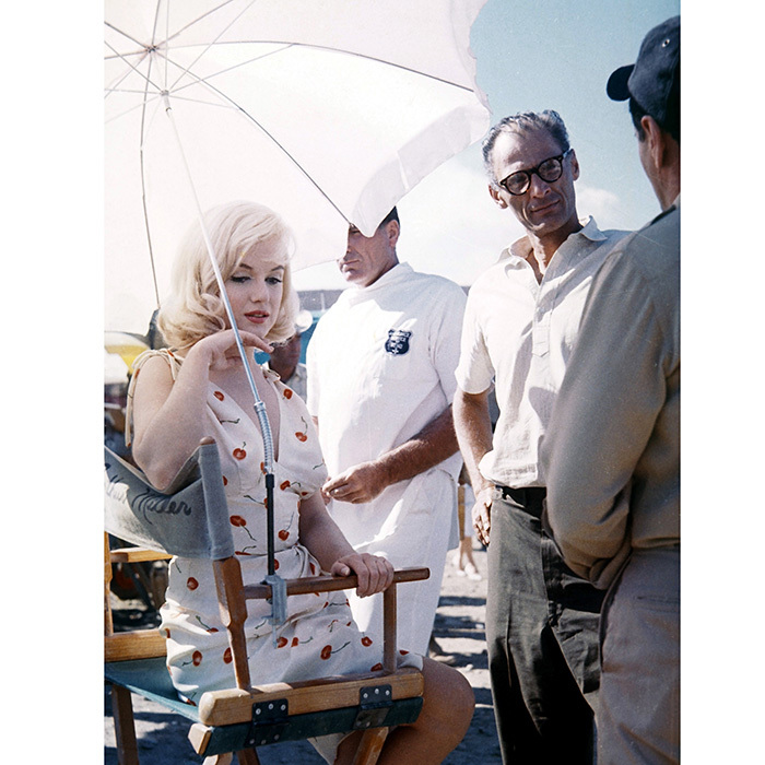Marilyn on the set of her final film, 1961's <I>The Misfits</I>, wearing the famed cherry print dress designed by Jean Louis.