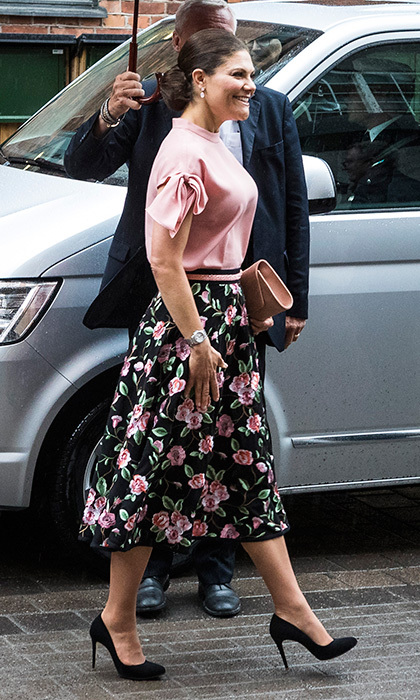 Crown Princess Victoria got on board with the statement sleeves trend in a pink top and floral skirt as she visited Danish architecture firm Arkitema.