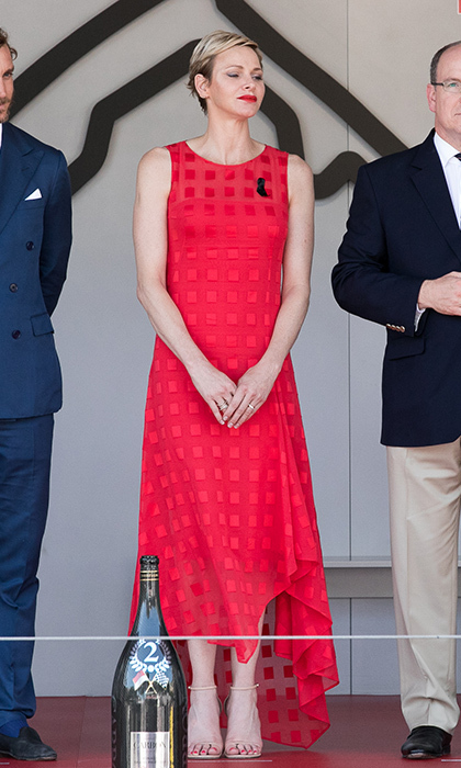 Princess Charlene wore vibrant red as she helped fellow Monaco royals hand out winners' trophies at the 2017 Monaco Grand Prix in Monte-Carlo. 