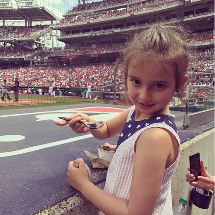 Arabella enjoyed some ice cream during her first-ever baseball game to watch the Mets play the Nationals.