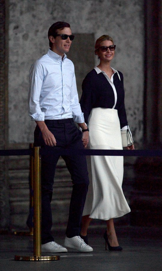 A dark blouse with detail to match her creme-colored midi skirt for Ivanka's outing to the Pantheon in central Rome with husband Jared in May 2017.
