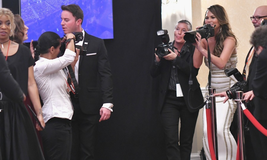 June 11: Lights, camera, Chrissy! Chrissy Teigen played photographer in the Tony Awards media room after her husband John Legend took home the award for Best Revival of a Play for <i>Jitney</i>.