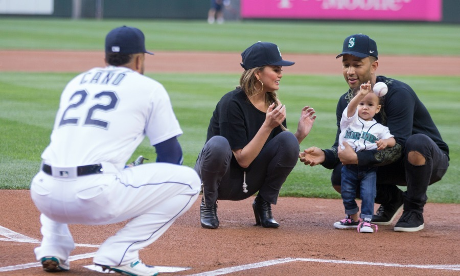 June 6: Play ball! John Legend and Chrissy Teigen's little girl, Luna tossed the first pitch to Robinson Cano #22 of the Seattle Mariners before his team saw the Minnesota Twins at their home field in Seattle. 