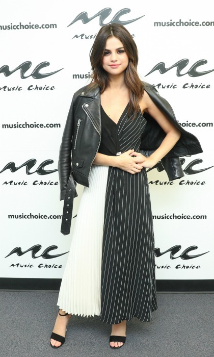 June 5: Selena Gomez literally took on NYC in style during her press day. The <i>Bad Liar</i> singer wore a black and white number by Shaina Mote during her appearance at Music Choice. 
