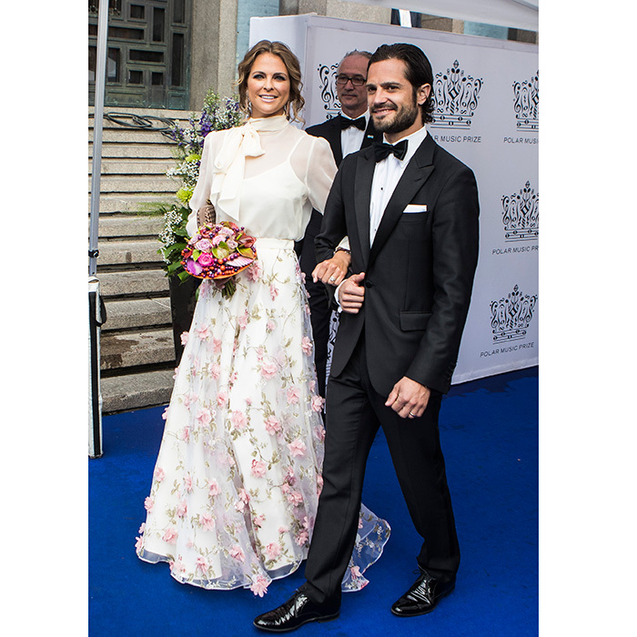 With their respective spouses Chris O'Neill and Princess Sofia sitting out the Polar Music Prize gala, Princess Madeleine of Sweden and her brother Prince Carl Philip teamed up for the show's red capret on June 15 in Stockholm.