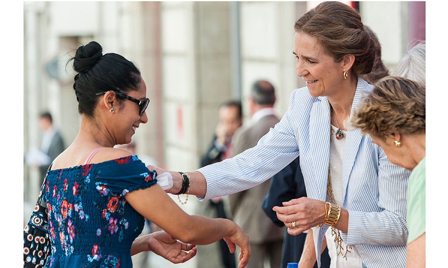 King Felipe's sister Princess Elena of Spain helped staff a table for the Caritas charity in the streets of Madrid during the city's 'Charity Day' on June 15.