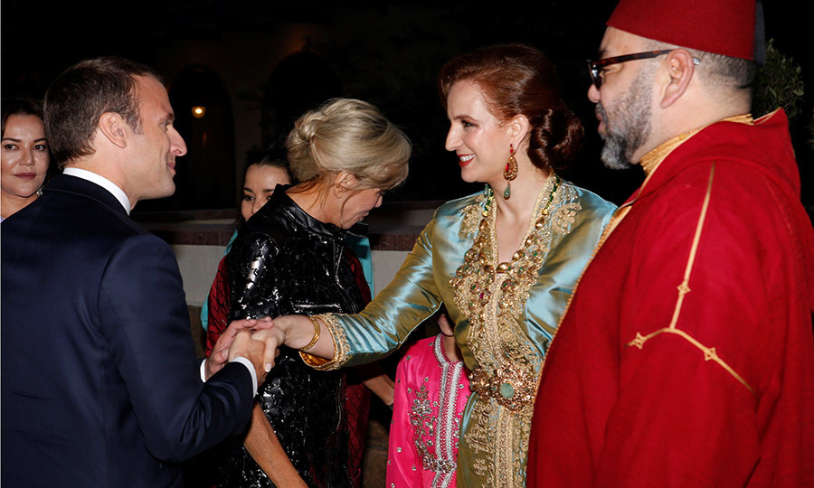 Morocco's King Mohammed VI and his wife Princess Lalla Salma, right, greeted French President Emmanuel Macron and his wife Brigitte as they arrived for a dinner held at the Royal Palace in Rabat.
