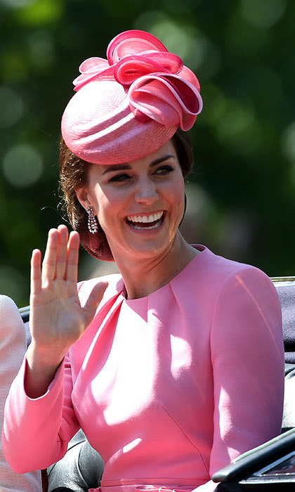 Pretty in pink! As per usual, the Duchess of Cambridge looked radiant at the Trooping the Colour parade on Saturday. The 35-year-old beauty wore a stunning pink Alexander McQueen dress with a matching Jane Taylor hat. Her shiny chocolate hair was swept to one side underneath the headpiece, in a sophisticated chignon. 