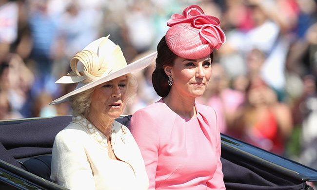 During the parade, the Duchess of Cambridge rode next to Camilla, Duchess of Cornwall, who wore an elegant cream number. Kate later joined her husband Prince William and their two children, Charlotte and George.