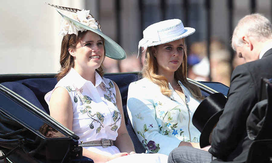 Flower sisters! Princesses Beatrice and Eugenie looked elegant wearing similar white, floral outfits and matching hats at the Trooping the Colour. The sisters sat in the carriage with their father Prince Andrew as they smiled for the crowds gathered for the Queen's birthday celebrations. Beatrice and Eugenie seemed happy and relaxed at the annual royal parade.