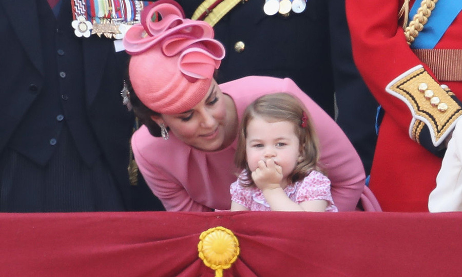 Princess Charlotte was mesmerized by the crowd that gathered below Buckingham Palace during her great-grandmother's special day.