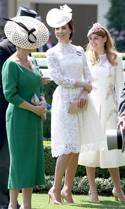 Catherine, Duchess of Cambridge attended Ascot for the second time ever wearing a long-sleeved Alexander McQueen dress with a high collar and peplum waist. The royal accessorized with her signature nude accessories – pumps and a clutch – as well as a lace fascinator.