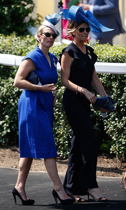 Queen Elizabeth's granddaughter Zara Tindall – wearing royal blue, natch – strolled along with a friend.