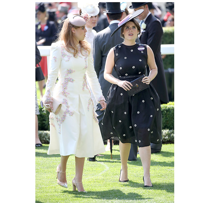 Royal sisters Princess Beatrice, left, and Princess Eugenie, right, wore contrasting looks in cream and navy, respectively.