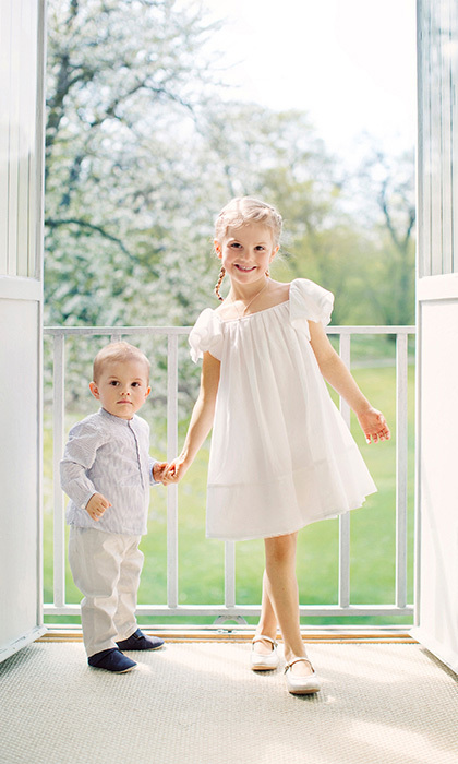 Princess Estelle and her younger brother were picture perfect as they posed for a new set of official portraits, released by the Swedish royal palace to celebrate Midsummer. 