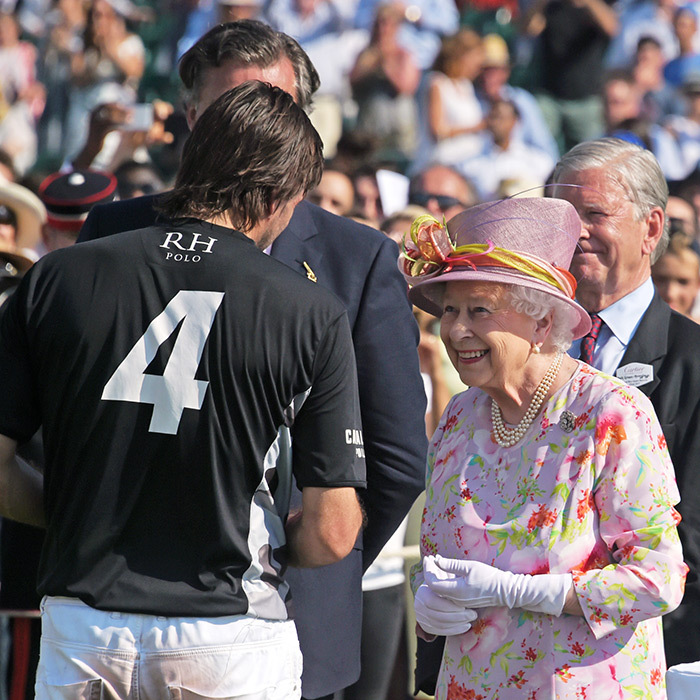 A smiling Queen Elizabeth chatted with polo players during the Cartier Queen's Cup Polo final at Guards Polo Club in Egham, England on June 18.