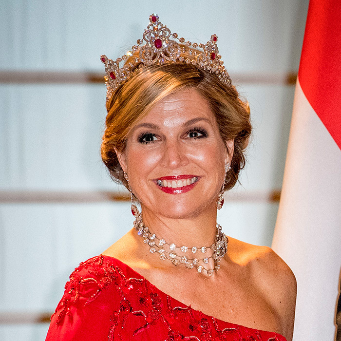 Queen Maxima of the Netherlands had a special sparkle during a state dinner in Milan. The royal donned the Mellerio Diamond and Ruby tiara for the occasion, which she paired with a striking one-shoulder red gown.