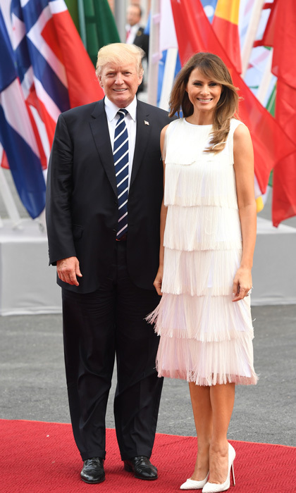 The First Lady of the United State gave off Gatsby vibes wearing a 1920s-inspired tiered fringe flapper dress by Michael Kors ($2995) to a concert at the Elbphilharmonie concert hall during the G20 Summit in Hamburg, Germany. Melania completed her stunning look with matching python Christian Louboutin pumps.