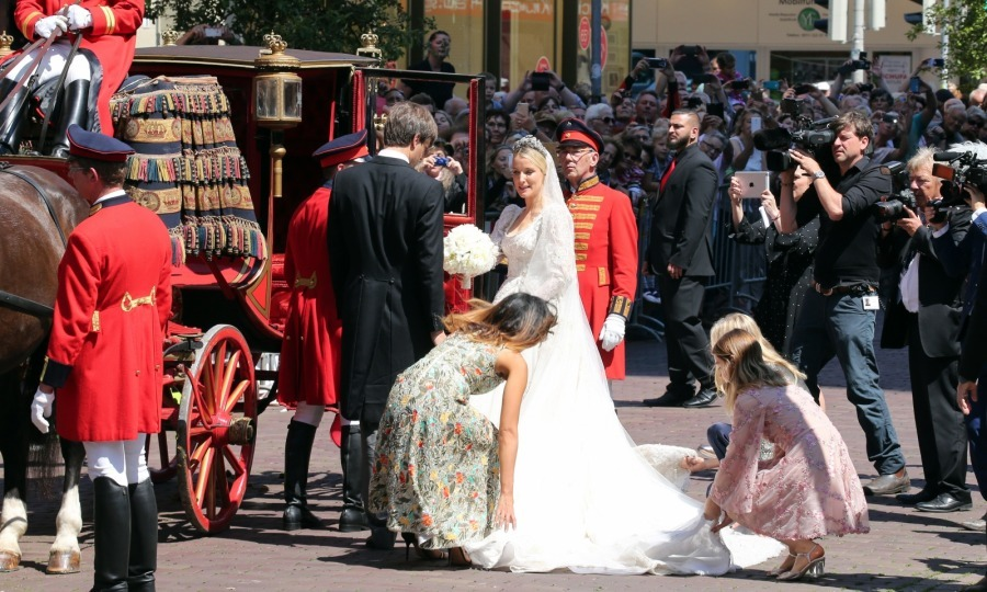 The ceremony was a fanfare, complete with a stunning silk-lined carriage and traditional costumes.