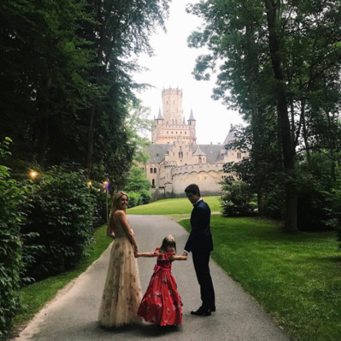 Though the receptions were private, Princess Olympia of Greece, with Flynn Busson, gave a glimpse of the party with this glamorous photo snapped outside Marienburg Castle.