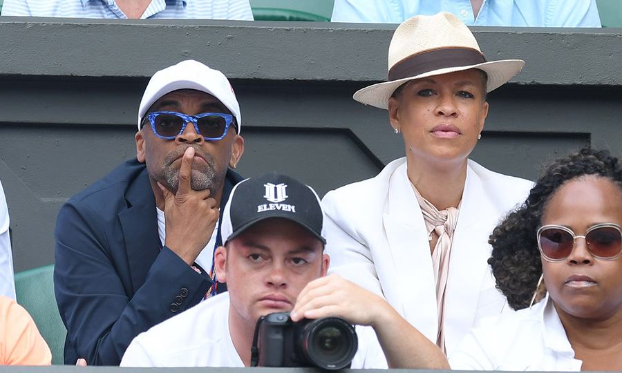 Film director Spike Lee, joined by wife Tonya Lewis Lee, kept his eye on the ball.