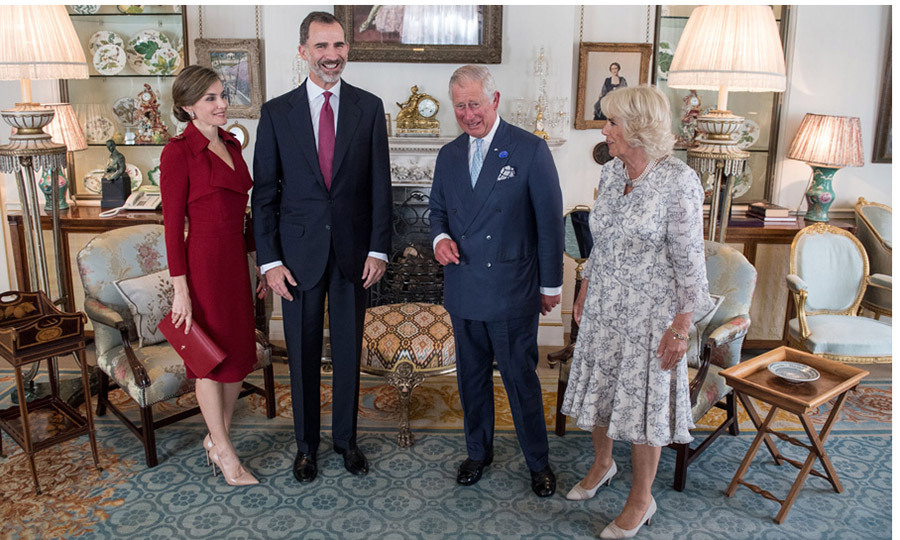 Queen Letizia changed into a red ensemble for tea with Prince Charles and Duchess Camilla at Clarence house.