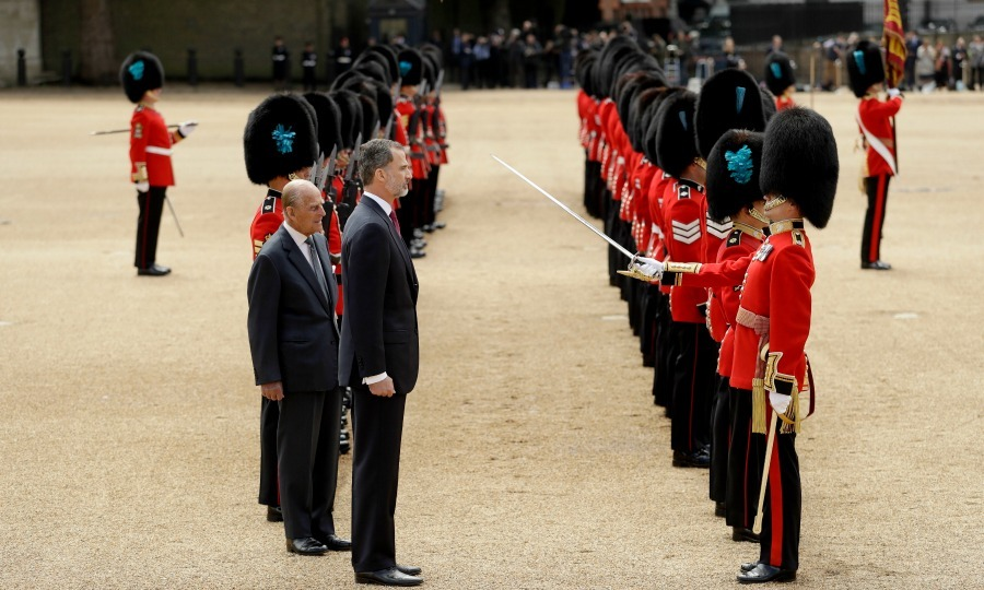 The Spanish king stood next to Philip as the two royal men inspected the Guard of Honor.