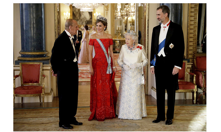 Prince Philip escorted Queen Letizia to the formal dinner, while King Felipe was at Queen Elizabeth's side.