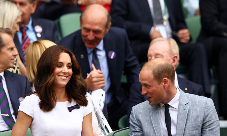 Kate, who is royal patron of Wimbledon, was all smiles with her husband as they cheered on Roger Federer.