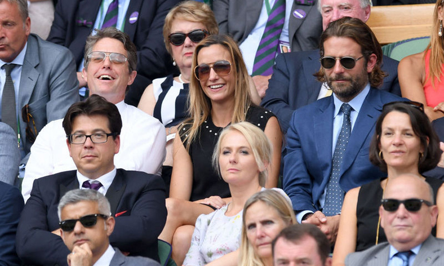Hugh Grant and his girlfriend Anna Ebertsein sat next to Bradley Cooper during the men's final.