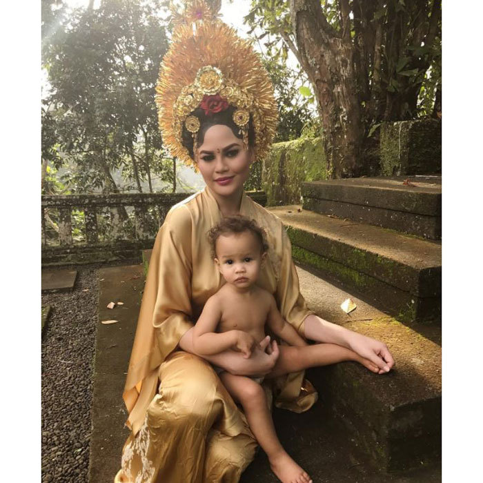 Chrissy Teigen and Luna dressed up in traditional costume during their family trip to Bali. The supermodel posted one photo in a silk gown with a gold headdress with their 15-month-old daughter.